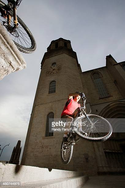 Mountain Biker Jumping in Front of Cathedral