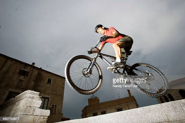 Mountain Biker Jumping in Urban Setting
