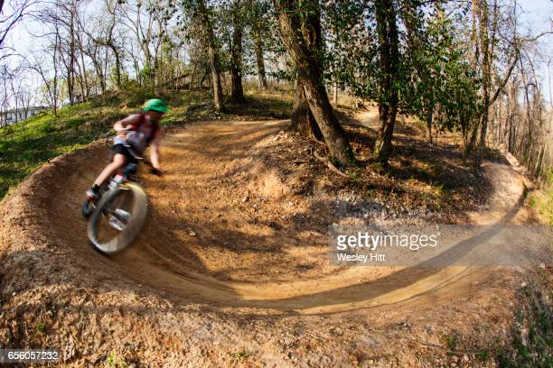 mountain biker making a turn in the dirt