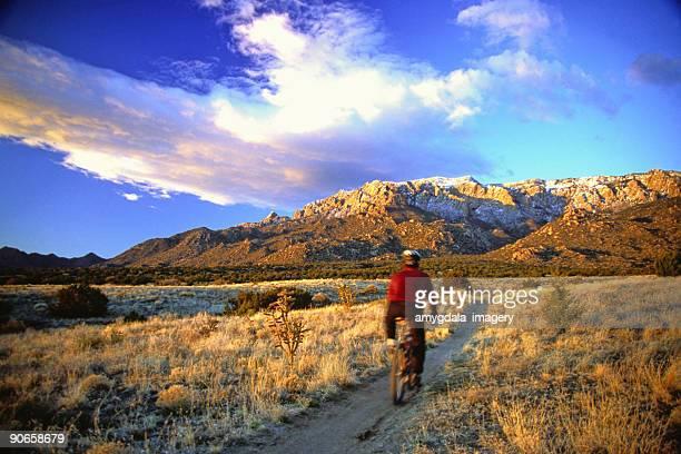 mountain biker motion blur landscape sunset
