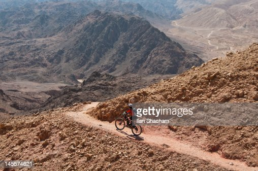 Mountain biker on singletrack in desert