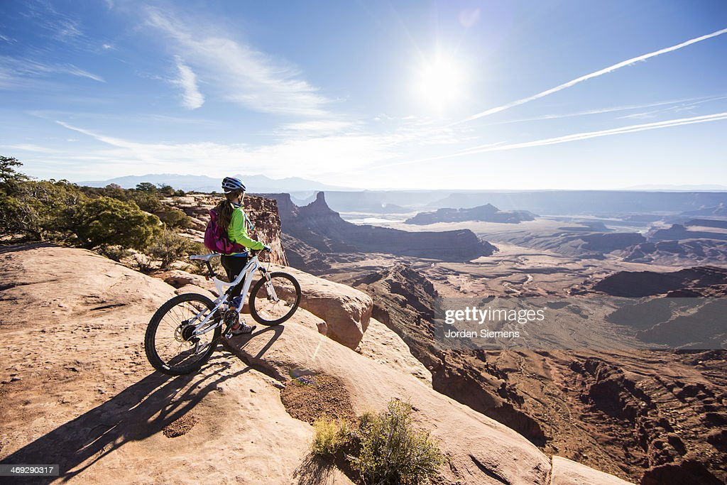 Mountain biker on top of a cliff : Stock Photo