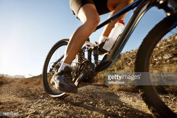 Mountain biker riding bike on a sunny day