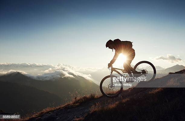 Mountain biker riding downhill, Valais, Switzerland
