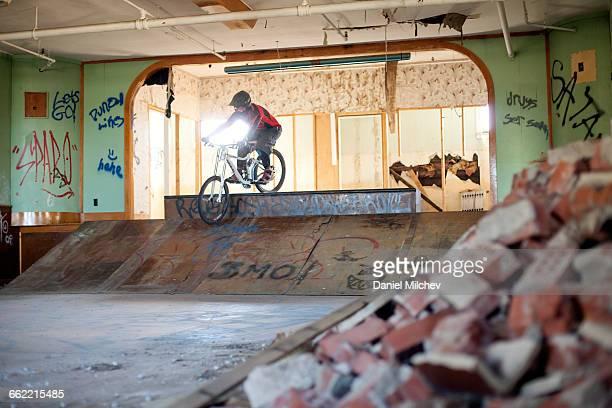 Mountain biker riding inside an abandoned building