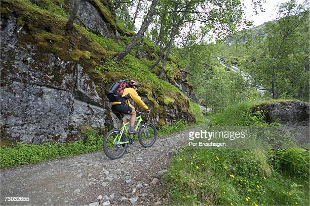 Mountain biker riding on footpath
