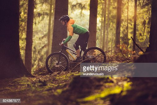 Mountain Biker Riding On Forest Track