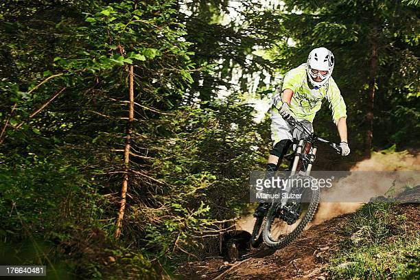 Mountain biker skidding on forest track