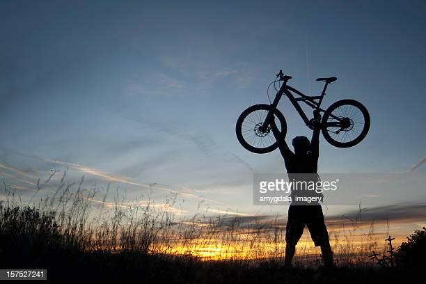 mountain biker sunset silhouette