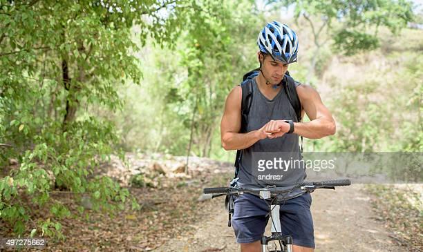 Mountain biker using a smart watch
