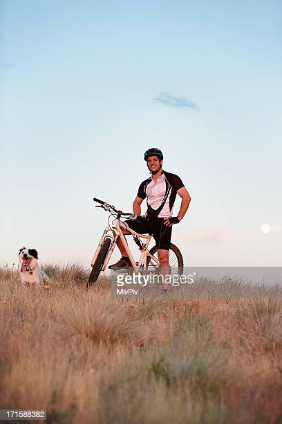 Mountain biker with dog