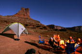 Mountain bikers cook dinner under a sky laiden sky on a full moon night at the Airport campsite on the White Rim Trail on October 25 2007 in...