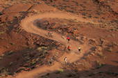 Mountain bikers decend the double track trail as leave leave the Murphy campsite on the White Rim Trail on October 27 2007 in Canyonlands National...