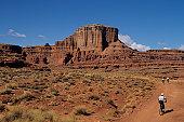 Mountain bikers on trail at Hurrah Pass, near Moab, Utah, USA