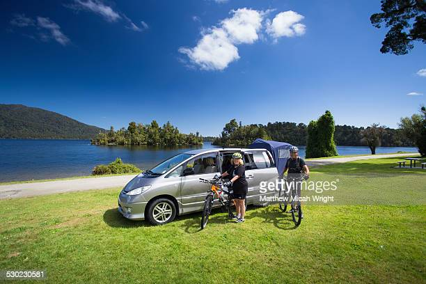 Mountain BIkers pull up to a lakeside campsite