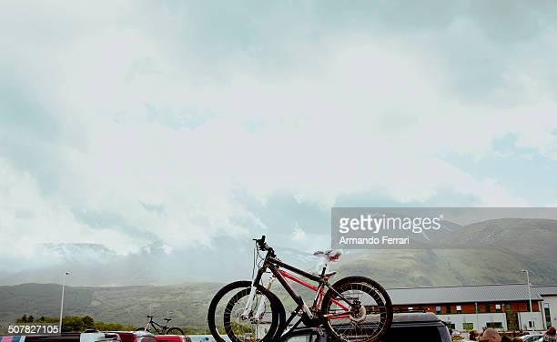 Mountain bikes on roof rack in parking lot, Scottish Highlands, Scotland