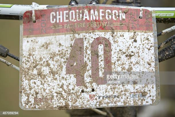 Chequamegon Fat Tire Festival Closeup of sign caked in mud on bike after off road race from Cable to Hayward Cable WI CREDIT Tom Lynn