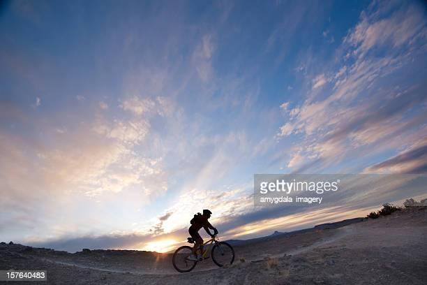 mountain biking silhouette sunset sky