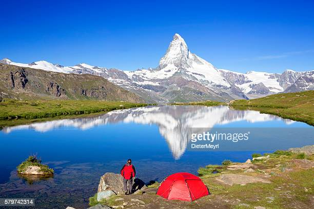 Mountain camping at sunny day with view to Matterhorn