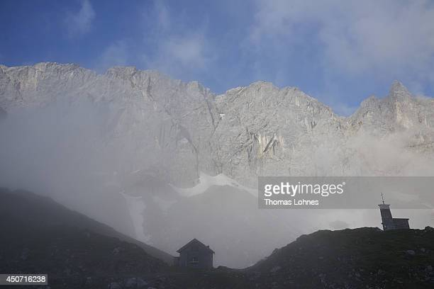 A mountain chapel and the 'Lamsenspitze' at the Karwendel region pictured on June 14 2014 near Vomp Austria The Karwendel is the largest range of the...