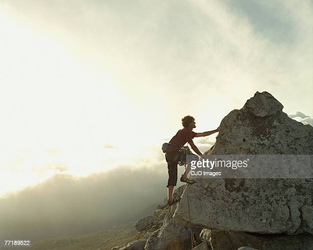 A mountain climber reaching the top of a mountain