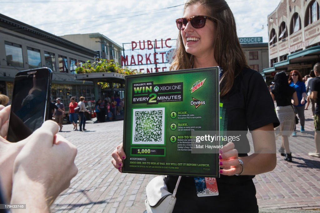 A Mountain Dew® representative holds up a limited scan 'Every 2 Minutes' QR code worth 1000 points for fans to scan at the Pike Place Market in Seattle, Wash. Over 100 QR codes were scattered throughout the Washington State Convention Center and select world-famous spots in Seattle for PAX Prime 2013 on September 1, 2013 in Seattle, Washington.