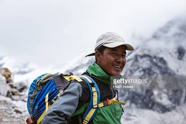 Mountain expedition sherpa and trekking guide Sange Sherpa on the trail near Gorak Shep like many guides Sange's family run a small tea house in...