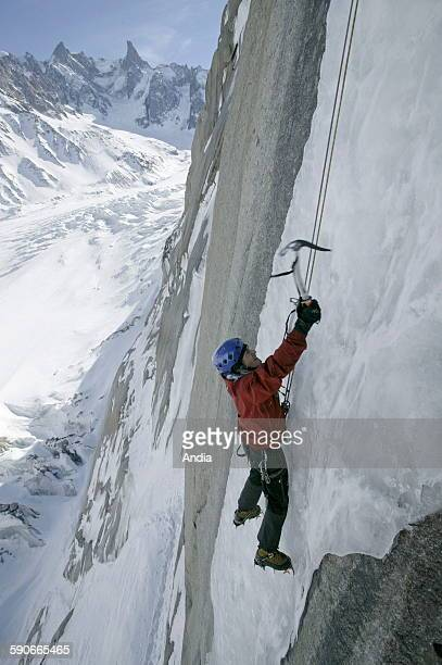 Mountain guide Francois Marsigny on a frozen waterfall White Valley Mont Blanc Massif