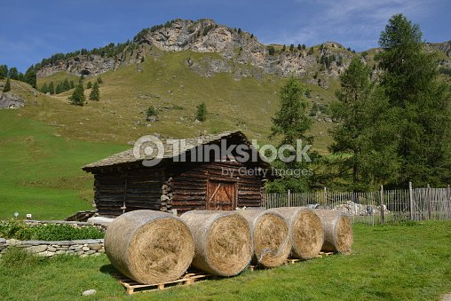 Mountain Hut With Hay Rolls Stock Photo Thinkstock