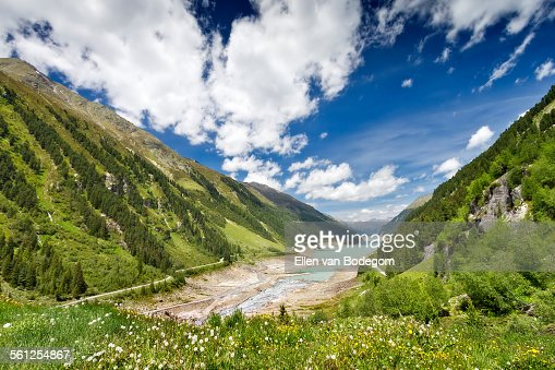 Mountain landscape wit reservoir lake in Tyrol