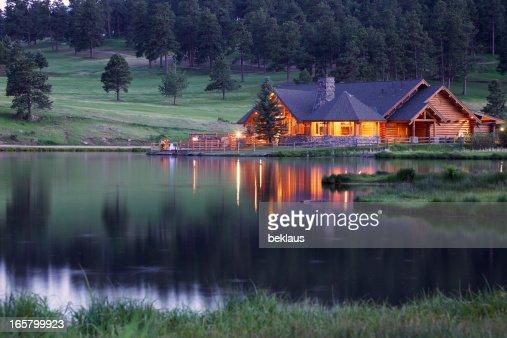 Mountain Lodge Reflecting in Lake at Dusk