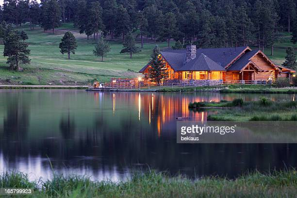Mountain Lodge Reflecting in Lake at Dusk
