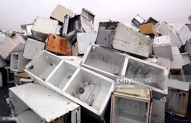 A mountain of discarded fridges are shown at a fridge disposal site in Trafford Park Industrial area on November 24 2004 in Manchester England The...