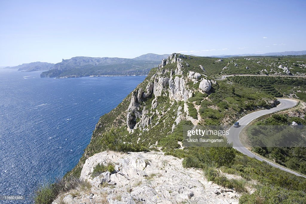 Mountain pass road at Mont de la Saoupe with view of the bay of Cassis on June 22, 2013 near Cassis, Cote d'Azur (French Riviera), France.