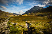 mountain path leading to lake at Cwm Idwal, Devils Kitchen, Llyn Idwal, Ogwen Valley, Snowdon, wales