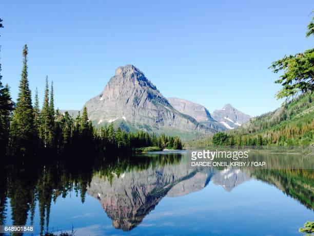 Mountain peak reflecting on lake