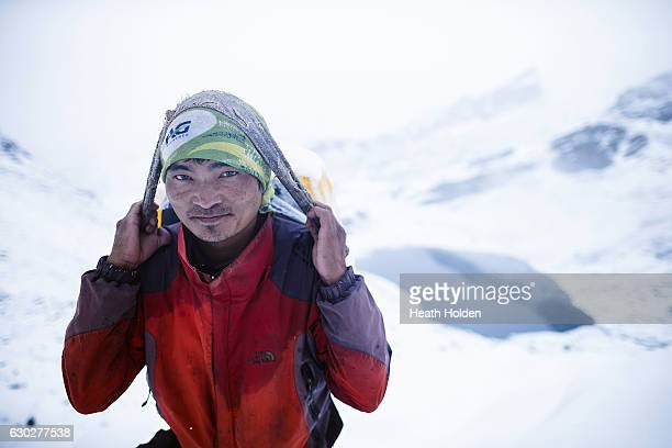 Mountain porters like Lahkpa Nuru have amazing stamina and strength 6 hours of climbing to get to the top of 5400m Renjo La Pass and towards Gokyo...