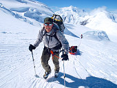 Mountain ranger Brian Scheele on this way to Windy Corner on Mount McKinley, also know as Denali, in Alaska. He is pulling a sled, that together with his heavy backpack is containing all the gear like tents, clothing and food.