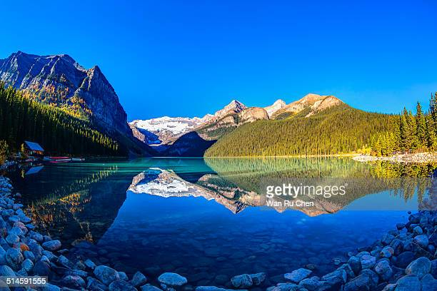 Mountain reflection on lake Louise at sunrise