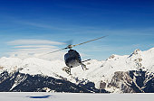 Mountain rescue helicopter in flight, Courchevel, France