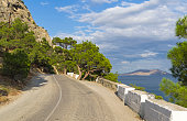 A mountain road along the seashore. Sunny summer day. (The road Sudak - Novyy Svet, Crimea).