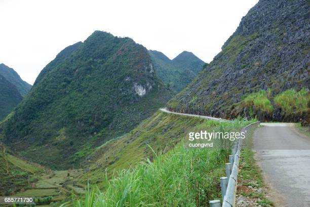 Mountain road in Ha Giang province Vietnam. Ha Giang shares a 270 km long border with Yunnan province of southern China and thus is known as Vietnam final frontier.