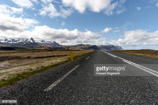Mountain road, low angle with snowcapped hills