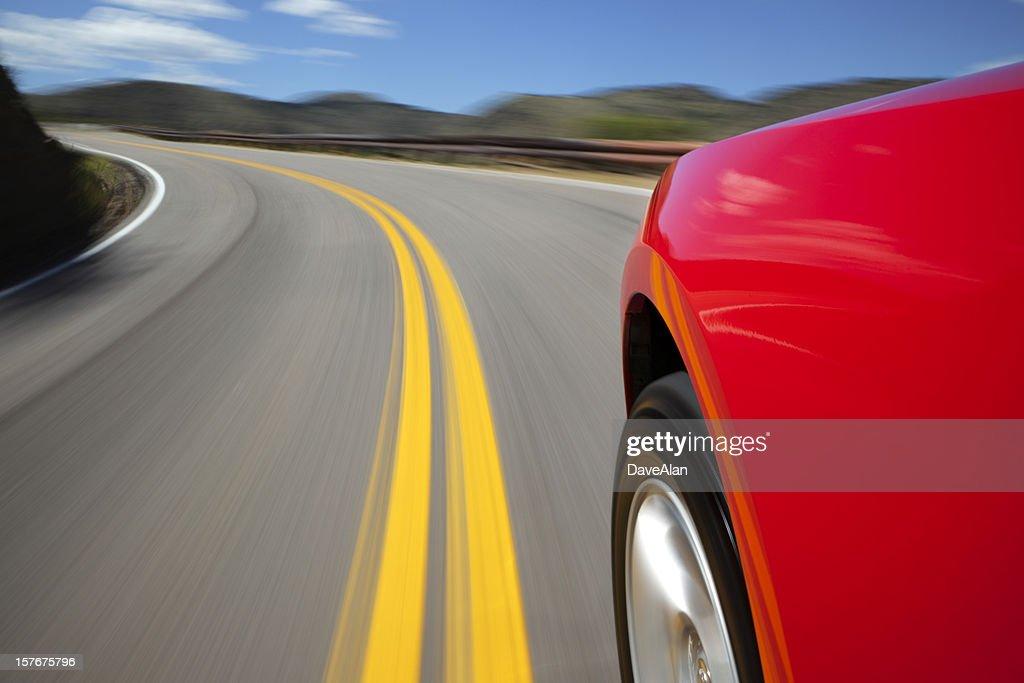 Mountain Road Speeding Car. : Stock Photo