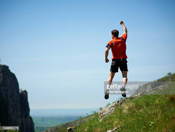 Mountain Runner Jumping in Air