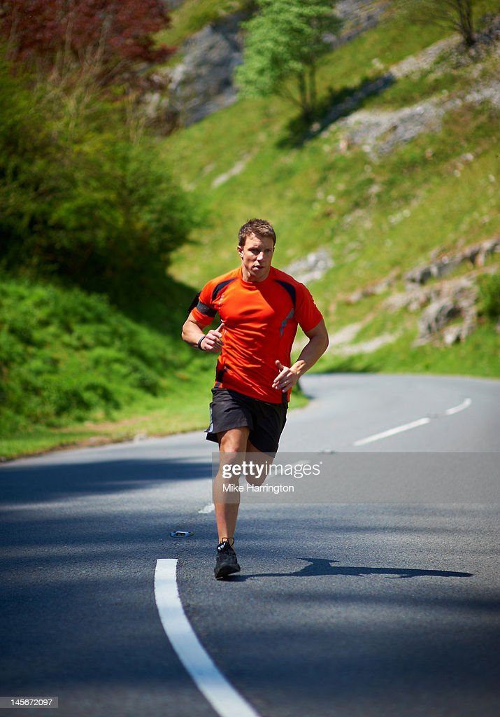 Mountain Runner Running Through Mountains : Stock Photo