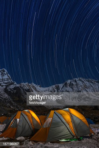 Mountain star trails over base camp tents Himalayas Nepal : Stock Photo