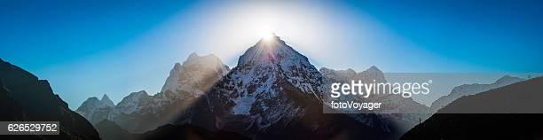 Mountain sunburst dramatic sunrise over Himalaya peaks panorama Khumbu Nepal