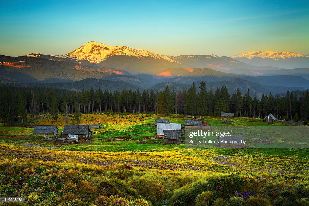 Mountain sunrise and abandoned shacks : Stock Photo