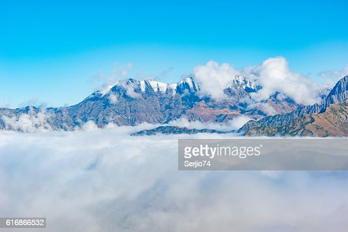 Mountain top above the clouds. : Stock Photo